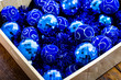 canvas print picture - Christmas decorations in a box. Christmas concept. Box with blue Christmas balls and garlands.