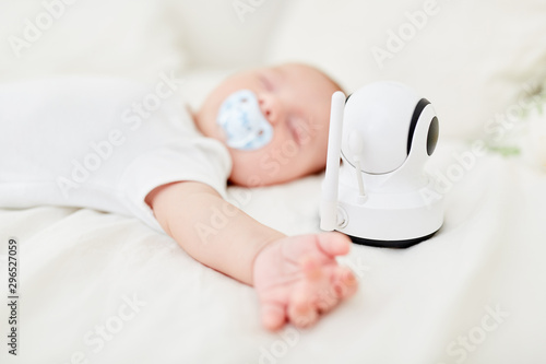 Baby is being monitored with baby monitor while sleeping Canvas Print