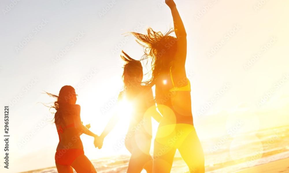 Fototapety, obrazy: Girls running on Beach, having Party at golden Summer sunset background