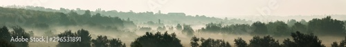 Panoramic view of a beautiful foggy countryside landscape at summer sunrise Fototapete