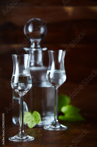 Two glasses of grappa bianca and decanter Wallpaper Mural