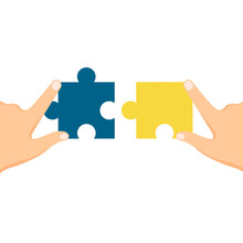 Hands Holding Jigsaw Puzzle. P...