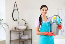 Beautiful Young Woman With Cleaning Supplies In Bathroom
