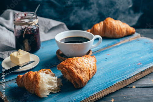 delicious croissants on wooden table Canvas-taulu