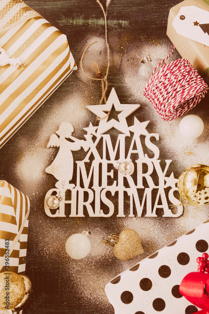 Fototapety, obrazy: Studio shot of a beautiful decoration for christmas on a rustic blue background, top view, flat lay,snow sprayed above, christmas and winter holidays concept.
