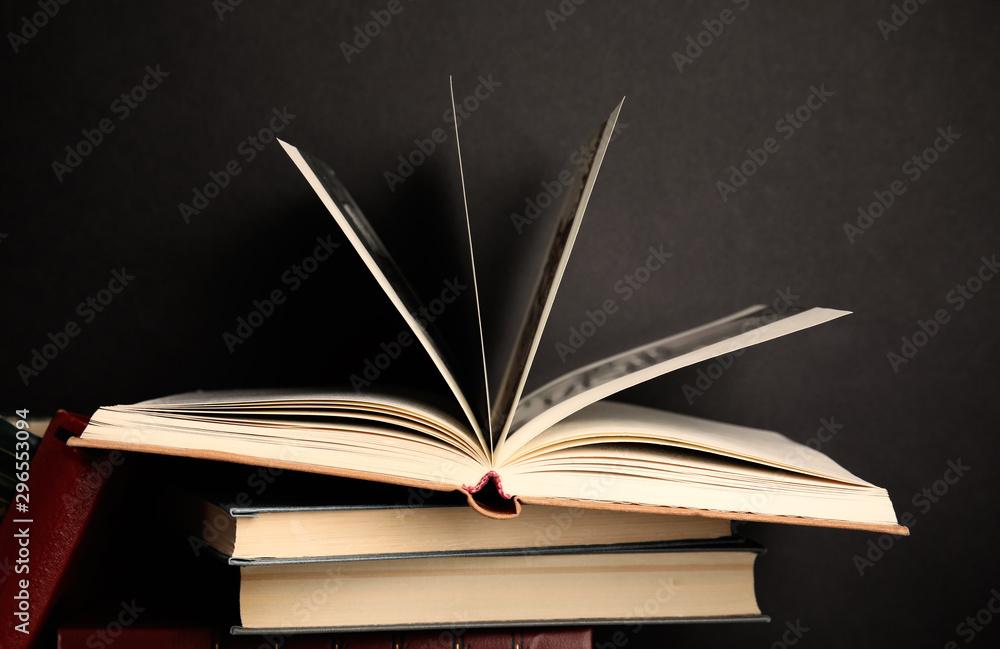 Fototapety, obrazy: Different old hardcover books against black background