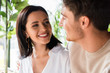 selective focus of happy woman looking at man