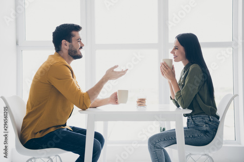 Leinwand Poster  Profile photo of handsome guy and his pretty lady looking tender eyes drinking h