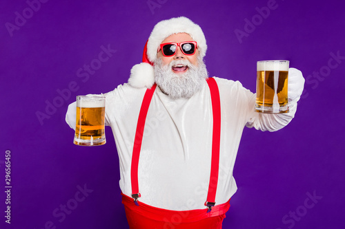canvas print motiv - deagreez : Portrait of nice drunk cheerful cheery glad bearded thick fat Santa having fun offering drinking beer night club bar isolated over bright vivid shine vibrant violet lilac background