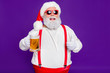 canvas print picture - Close-up portrait of his he nice cheery glad cheerful satosfied bearded thick fat Santa drinking beer showing thumbup isolated over bright vivid shine vibrant violet lilac background