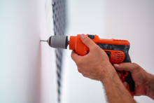 Drilling A Hole On The Wall Fo...