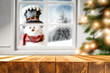 canvas print picture - Desk of free space for your decoration and winter window background with snowman