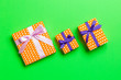 Leinwandbild Motiv Gift box with purple and pink bow for Christmas or New Year day on green background, top view