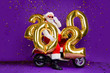 canvas print picture - Full body photo of fat santa man sitting on bike holding big air newyear 2020 numbers balloons confetti falling wear sun specs x-mas costume isolated purple background