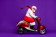 canvas print picture - Photo of fat santa claus role man rushing newyear x-mas theme party by bike cool modern style wear sun spectacles trousers hat suspenders isolated purple background