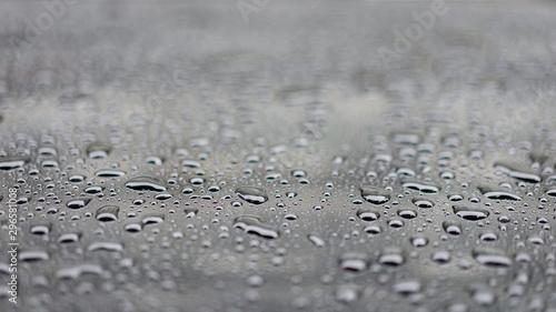 Fototapeta  Water drops splash on the black floor, selective focus.