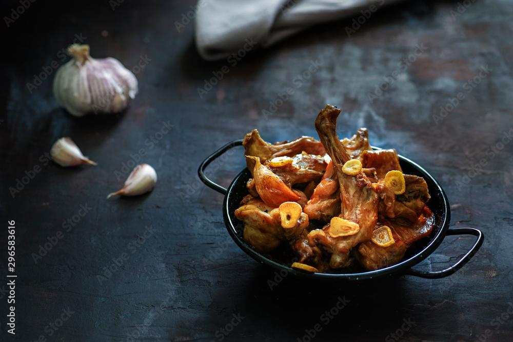 Fototapety, obrazy: Rabbit with garlic - typical Spanish dish