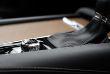 Close-up Image Of The Electronic Engine Start Button Seen On A European, Luxury Built SUV Vehicle. Showing Some Of The Leather Wrapped Gear Shift And Walnut Trim.