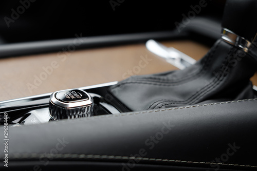 Fototapeta Close-up image of the electronic engine start button seen on a european, luxury built SUV vehicle