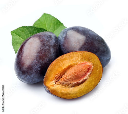 Fresh plums with leaves.