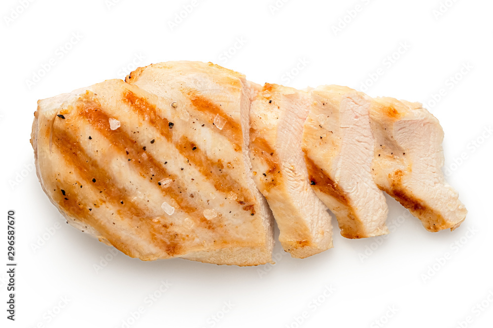 Fototapety, obrazy: Partially sliced grilled chicken breast with grill marks, ground black pepper and salt isolated on white. Top view.