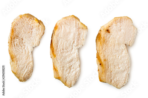 Stampa su Tela Three separated slices of grilled chicken breast isolated on white