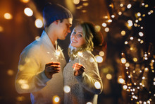 A Couple Celebrates Christmas Together With Lights