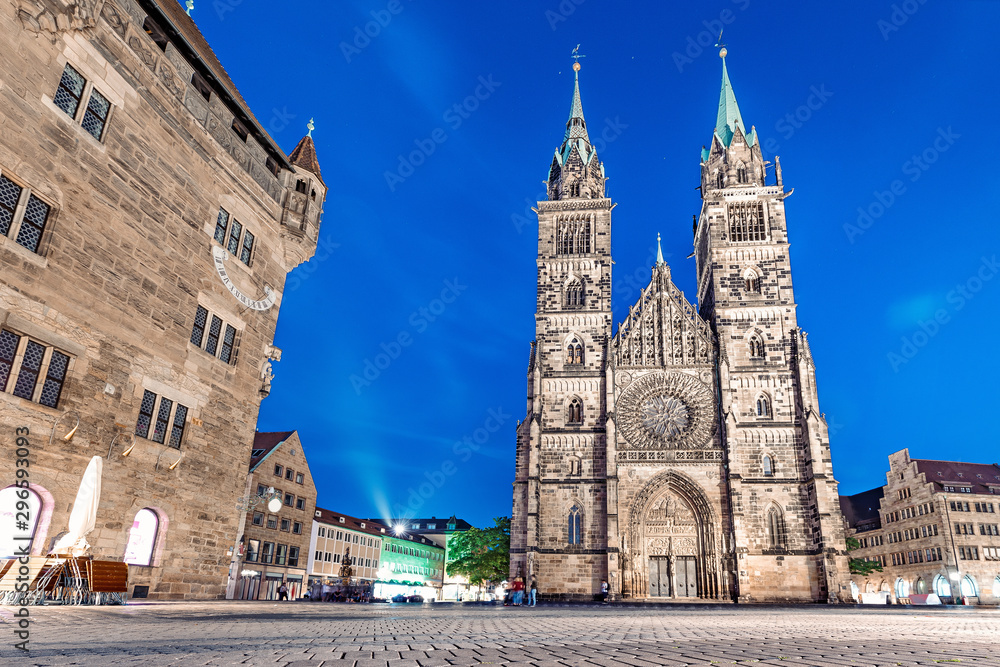 classic night view in Nuremberg on the illuminated building of the Church of St. Lorenz . Travel and sightseeing in Germany