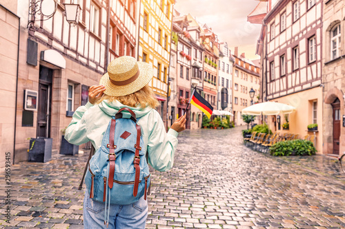 Fototapeta  Young asian woman tourist traveling with german flag near the famous half-timber
