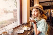 Portrait Of Beautiful Asian Woman Drinking Coffee In Retro Cafe Near Window