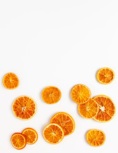 Christmas Composition With Dried Oranges Slices On White Background. Natural Dry Food Ingredient For Cooking Or Christmas Decor For Home. Flat Lay.