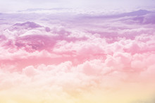 Beautiful Fantasy Pastel Clouds Againt With Top Of Hill As Paradise Background