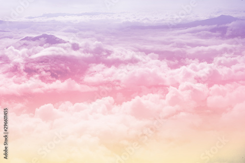 Obraz beautiful fantasy pastel clouds againt with top of hill as paradise background - fototapety do salonu