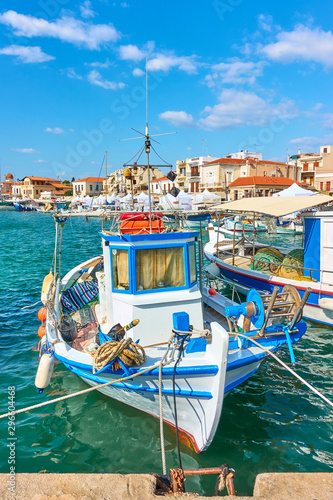 Stampa su Tela  Old fishing boat in the port of Aegina
