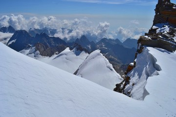 Gran Paradiso National Park, Italy. Climbing to the summit of mount Gran Paradiso 4 061 m with cats and ice ax. Sunny chilly day.
