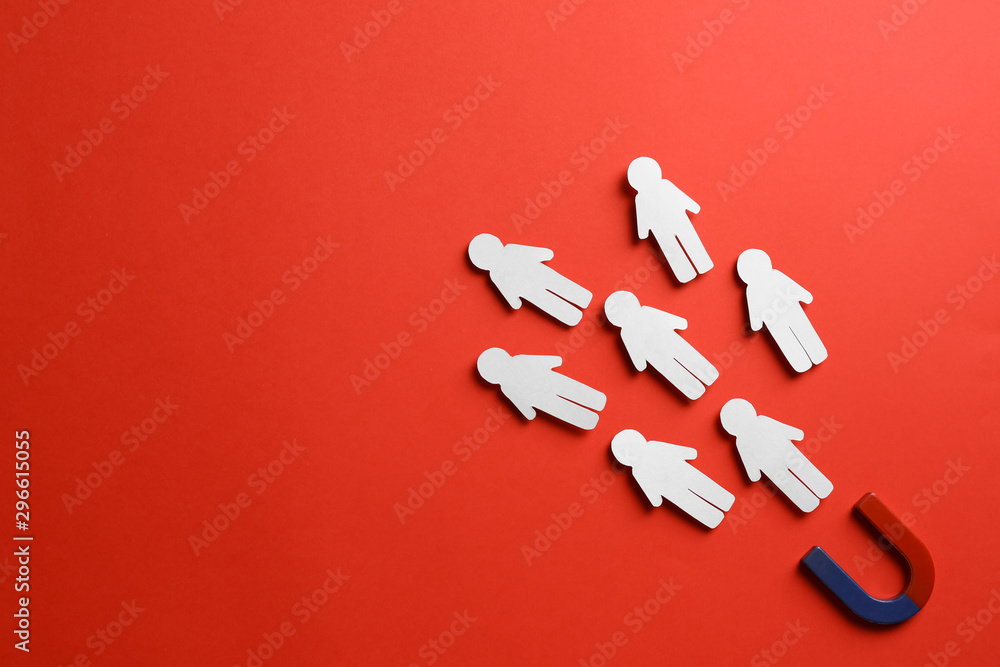 Fototapety, obrazy: Magnet attracting paper people on red background, flat lay. Space for text