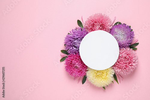 Flat lay composition with beautiful aster flowers and blank card on pink background Wallpaper Mural