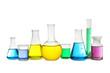 Leinwandbild Motiv Laboratory glassware with colorful liquids on white background