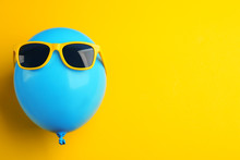 Balloon With Sunglasses On Yel...