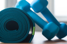 A Blue Rolled Yoga Mat. Two Bl...