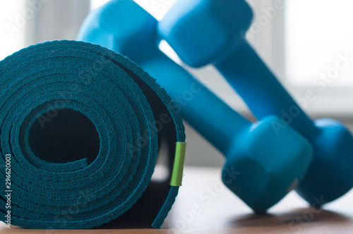 Carta da parati A blue rolled yoga mat