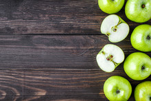 Ripe Green Apples And Apple Slices On Old Wooden Background.Vegetables For Diet And Healthy Eating.Organic Food. Place For Text. Top View
