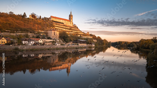 Tuinposter Oude gebouw Beautiful Panoramic view of an famous historical city, during a vibrant autumn sunrise. Located in Melnik with historical castle and river Vltava and famous vineyards. Melnik is 30 km north of Prague