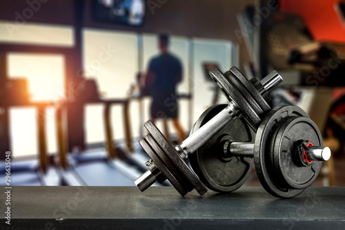 Fototapety, obrazy: Dumbbell, barbell and workout in the gym. Space for products and decorations or text with blurred gym background.