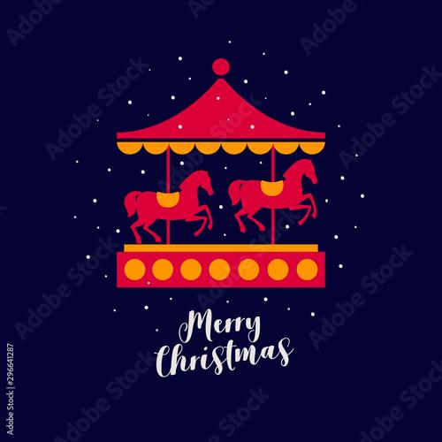 Fototapeta Image of festive carousel with red horses under falling snow