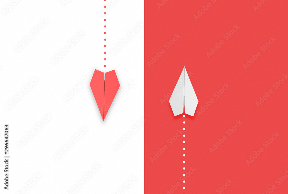 Fototapeta red and white paper airplane flying different directions.different thinking concept