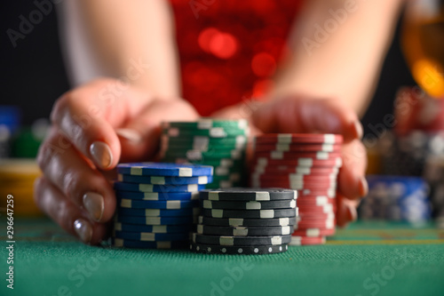 Tela Playing cards in a casino, raising bets with chips