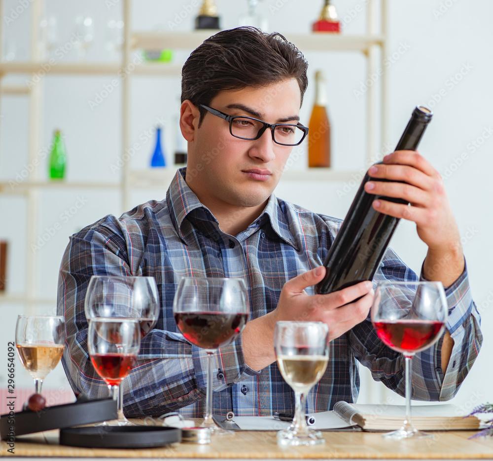 Fototapeta Professional sommelier tasting red wine