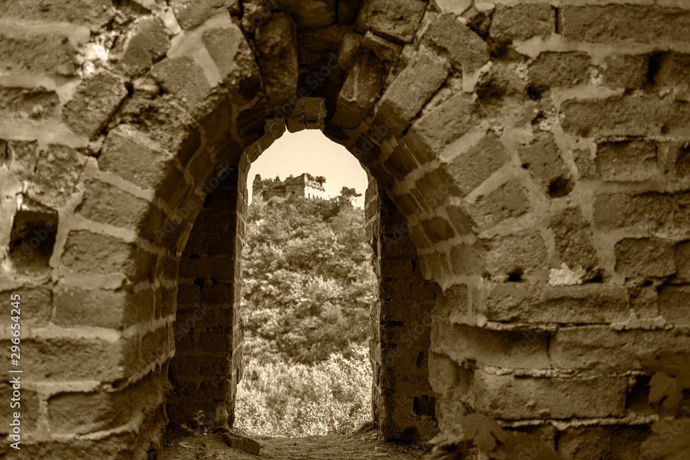 A close-up view of watchtower watchtower on the Great Wall, an ancient Chinese building, in yumuling, qianxi county, hebei province, China. Monochrome black and white, retro yellow creative