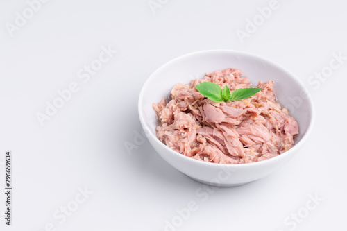 Canned tuna in a white bowl, isolated on white background; copy space, soft ligh Canvas Print